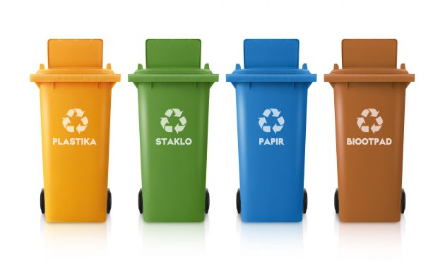 yellow, green, blue and red recycle bins with recycle symbol isolated on white background